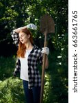 Small photo of Woman with a shovel, kitchen garden, cottage, summer house, summer, season, cleaning.