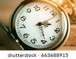 vintage pocket watch on wooden... | Shutterstock . vector #663688915