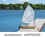 Small Sailboat On Dock At Lake