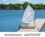 Small Sailboat On Dock At Lake