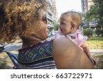 african american mother kissing ... | Shutterstock . vector #663722971