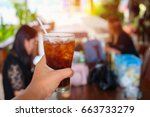 close up  hand holding glass of ...   Shutterstock . vector #663733279