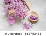 lilac cosmetics with flowers... | Shutterstock . vector #663753481