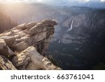 rock on a cliff edge. yosemite... | Shutterstock . vector #663761041