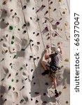 A Climber On A Rock Wall With...