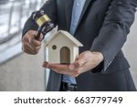 auctioneer knocking down a... | Shutterstock . vector #663779749