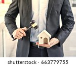 auctioneer knocking down a... | Shutterstock . vector #663779755