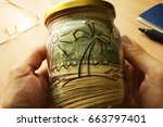 jar with dollars and picture of ... | Shutterstock . vector #663797401