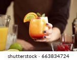 woman holding glass of tequila... | Shutterstock . vector #663834724