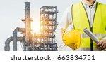 engineering man standing with... | Shutterstock . vector #663834751