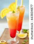 glasses of tequila sunrise... | Shutterstock . vector #663834877