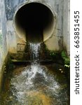 Small photo of Water flow from tropical monsoon drain.