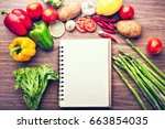 fresh vegetables on the wooden... | Shutterstock . vector #663854035
