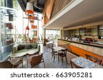 Stock photo interior of a modern urban cafeteria with concrete floor 663905281