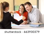 Small photo of Couple of happy customers ending contract and breaking it at office
