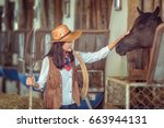 Cowgirls Working At A Horse...