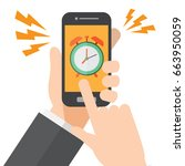 hand holds a smartphone  alarm... | Shutterstock .eps vector #663950059