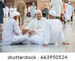 small group of men sitting and... | Shutterstock . vector #663950524