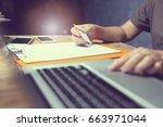 online payment man   hands... | Shutterstock . vector #663971044