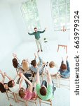 speaker at business meeting in... | Shutterstock . vector #663979324