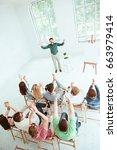 speaker at business meeting in... | Shutterstock . vector #663979414