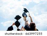 graduation caps thrown in the... | Shutterstock . vector #663997255
