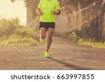jogging on the suburb road at... | Shutterstock . vector #663997855