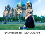 pretty gil sitting in front of... | Shutterstock . vector #664000795