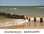 Old Pier Poles Of Wood On The...