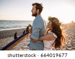 happy surfers couple standing... | Shutterstock . vector #664019677