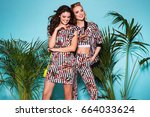 two fashionable women in nice... | Shutterstock . vector #664033624