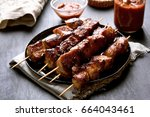 barbecue meat. grilled pork... | Shutterstock . vector #664043461