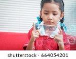 asian little girl using mobile...