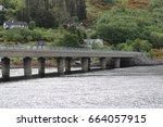 dornie bridge   the meeting of... | Shutterstock . vector #664057915