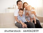 portrait of happy asian family... | Shutterstock . vector #664062859