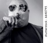Small photo of The big Boss, Head Honcho, Top Dog... An image of the Man in charge, smoking a cigar.