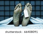 Small photo of dead body with toe tag