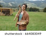 man in hat with firewoods and... | Shutterstock . vector #664083049