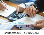 man working with a calculator... | Shutterstock . vector #664090261