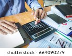 man working with a calculator... | Shutterstock . vector #664090279