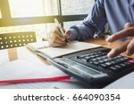 man working with a calculator... | Shutterstock . vector #664090354