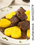 Small photo of Wild boar stew with polenta, cornmeal mush