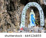 Grotto With A Statue Of The...