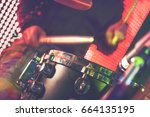 drummer detail and stage lights.... | Shutterstock . vector #664135195
