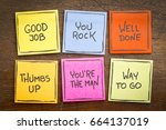 Small photo of way to go, good job, well done, you're the man, thumbs up, you rock - a set of colorful sticky notes with positive affirmation words against rustic wood