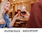 young people in a restaurant... | Shutterstock . vector #664149349