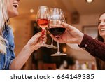 young people in a restaurant... | Shutterstock . vector #664149385
