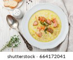Creamy fish soup with salmon, potatoes, onions and carrots. Kalakeitto. Traditional dish of the Finnish cuisine. Top view
