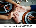 charming bridegroom holds the... | Shutterstock . vector #664172209