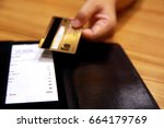 customer handed the credit card ... | Shutterstock . vector #664179769